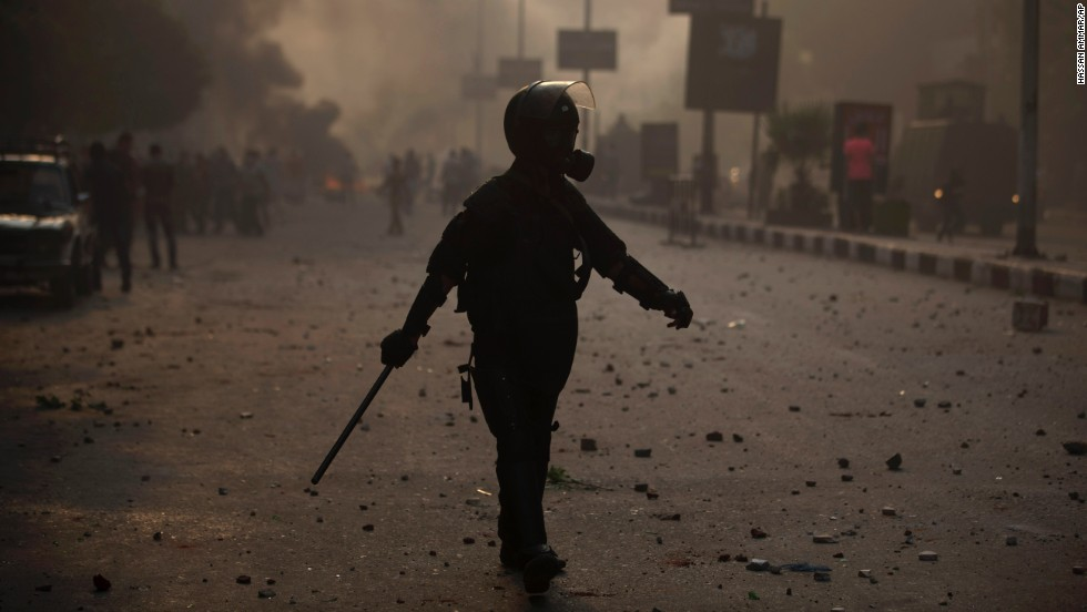 A riot police officer moves into position during clashes on October 6 in Cairo.