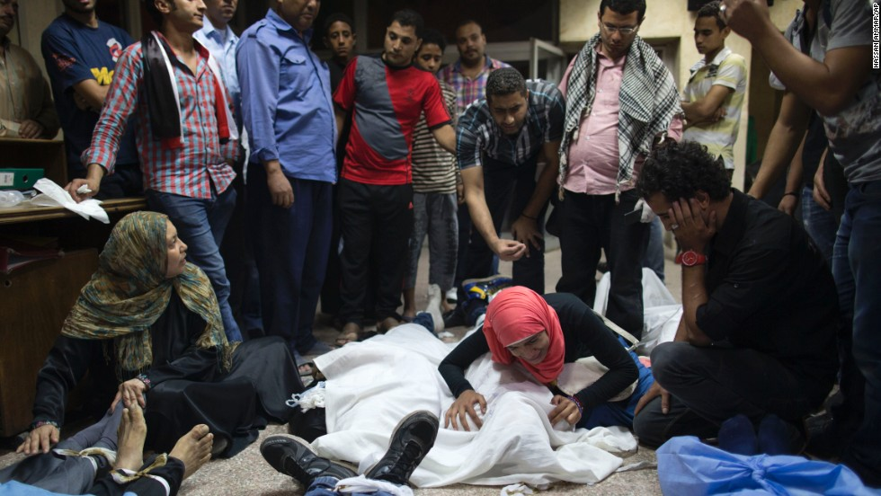 People mourn over the bodies of lost relatives on October 6 in Cairo.