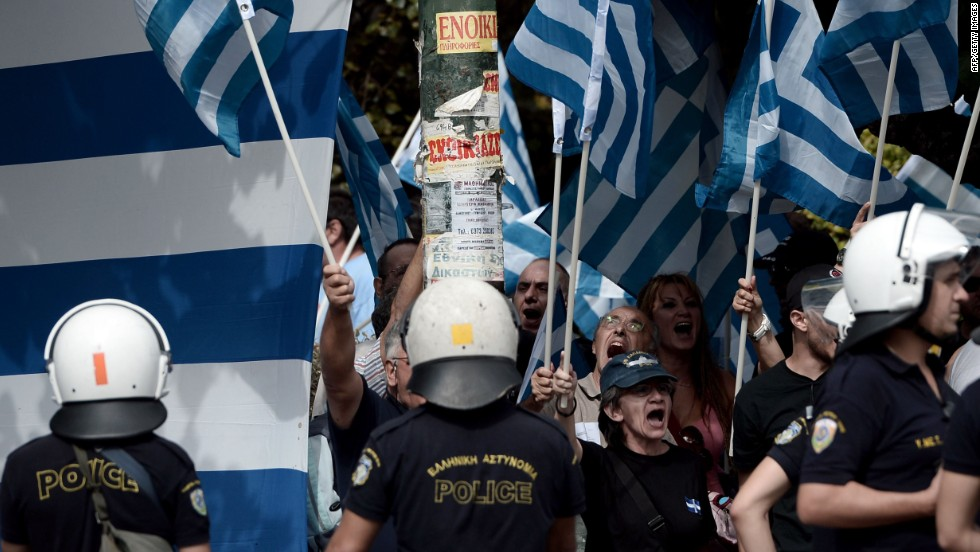 Supporters of Golden Dawn shout slogans outside a court in Athens on October 2, 2013.
