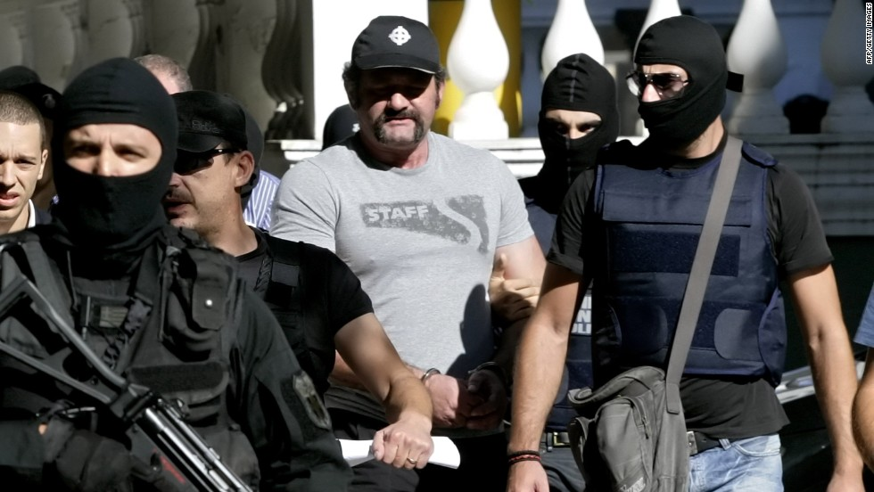 Extreme-right Golden Dawn party lawmaker Ioannis Lagos is escorted by anti-terror police after judicial authorities sent him to jail ahead of his trial, on October 2, 2013 in Athens, Greece.