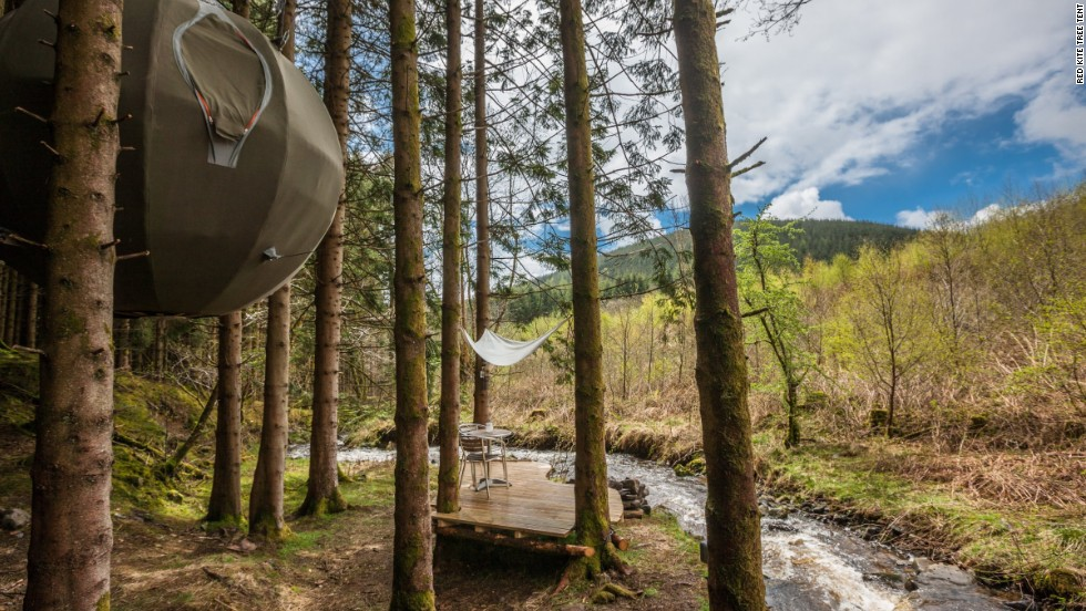 The Red Kite Tree Tent is a cozy, wool-lined orb for two, complete with stream and fire pit.