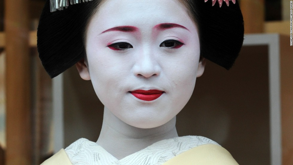Ichimari, 18, from Kami Shichiken, sports the same white makeup used by geisha centuries ago. It's meant to make their skin glow as they dance in dim, candle-lit rooms.