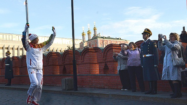 A first member of the Olympic Flame relay across Russia leaves the Kremlin in Moscow on October 6, 2013, starting the Olympic Flame relay for the XXII Winter Olympic Games Sochi 2014 across Russia . AFP PHOTO / VASILY MAXIMOVVASILY MAXIMOV/AFP/Getty Images