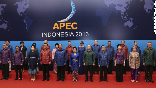 "Host country Indonesia's President Susilo Bambang Yudhoyono (C wearing blue) and his wife Ani (to his L) stand with other leaders of the Asia-Pacific region and their respective spouses, wearing traditional Balinese ""endek"" costumes for a group photo before a gala dinner hosted for the leaders at the Asia-Pacific Economic Cooperation (APEC) Summit in Nusa Dua on the Indonesian resort island of Bali on October 7, 2013."