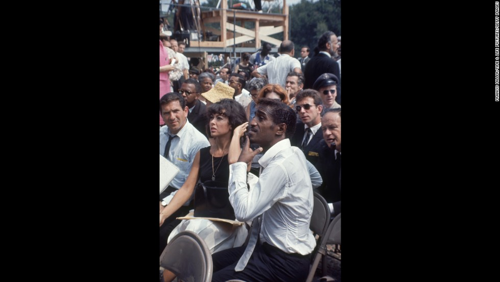 "Moreno sits with Sammy Davis Jr. at the March on Washington on August 28, 1968. ""I have always felt very Latina and very Puerto Rican, despite my efforts in my youth to be something I wasn't,"" Moreno told CNN. ""As I got older, I really realized that I carry with me a wonderful history, that we all do, not just myself. That's what makes this country so great: what we bring to it."""