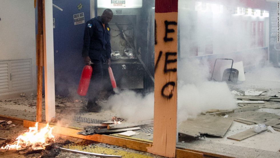 A fire extinguisher is used on destroyed cash dispensers on October 7.