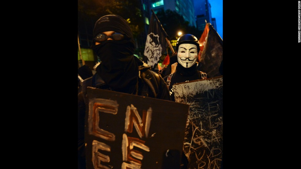 Demonstrators hold signs during the protest on October 7.