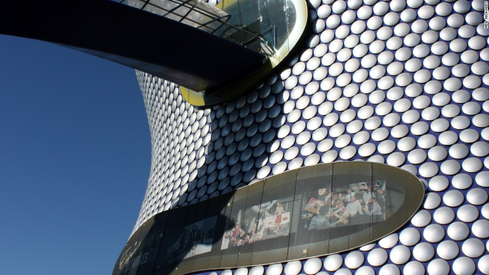 """A shopping center, the Selfridges Building is completely clad in 60-centimeter-wide, shimmering pieces of aluminum. The idea of a """"cave-like"""" shopping universe was the starting point for the building's futuristic design. The architects, Future Systems, won a total of six prizes for the design, including the 2004 RIBA Award for Architecture.<strong>Architect</strong>: Future Systems"""