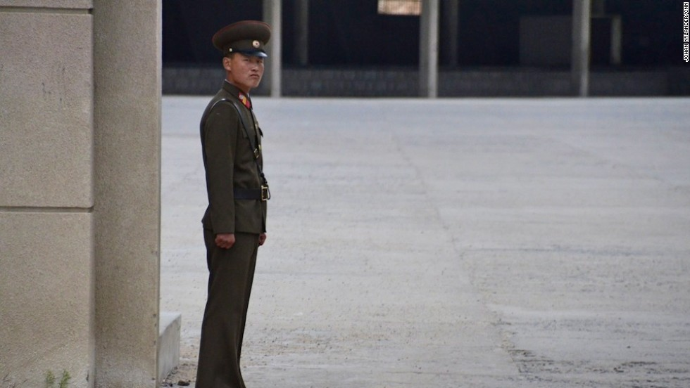 A stern looking North Korean guard by the Chinese border customs office. This image was deleted by North Korean officials.
