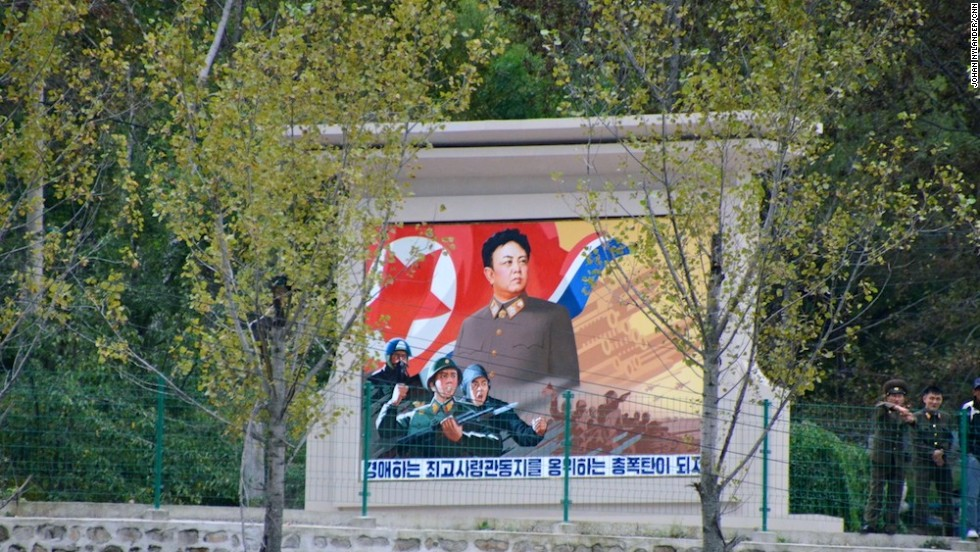 "This propaganda monument of ""Dear Leader"" Kim Jong-Il by a countryside road, not far from the border to China, was deleted by authorities. North Korea required images of leaders be full body shots."