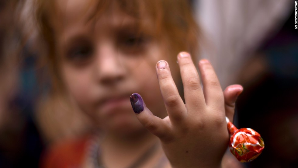 Polio, once a worldwide scourge, is endemic in just three countries now - Afghanistan, Nigeria and Pakistan.  Pictured here is Ameena, a Pakistani girl participating in an anti-polio campaign, showing her ink-marked finger after being vaccinated for polio in Rawalpindi, Pakistan, Monday, October 7, 2013.