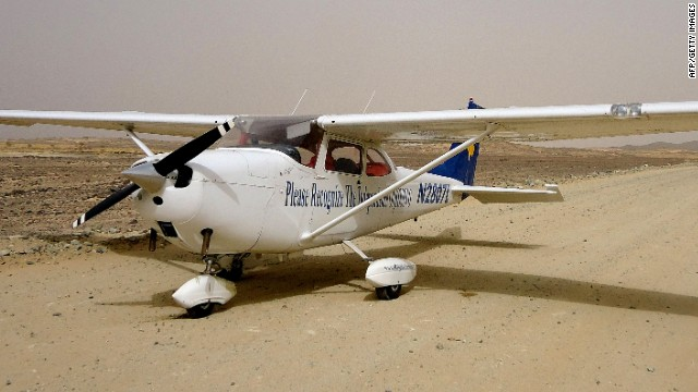 TO GO WITH AFP STORY BY SIMON MARTELLI The aircraft of Kosovar pilot James Barisha sits in the desert after he was forced to crash-land in the desert between Port Sudan and Khartoum on June 4, 2011. When he took off in his Cessna 172 from Texas two years ago, James Berisha vowed to visit every nation on earth to raise awareness of his beloved homeland, Kosovo, proclaimed independent a year earlier. His dream came close to ending in tragedy, when an engine cylinder blew at 8,500 feet, forcing him to crash-land in the Sudanese desert when he was just two countries short of conquering the African continent. AFP PHOTO/STR (Photo credit should read -/AFP/Getty Images)