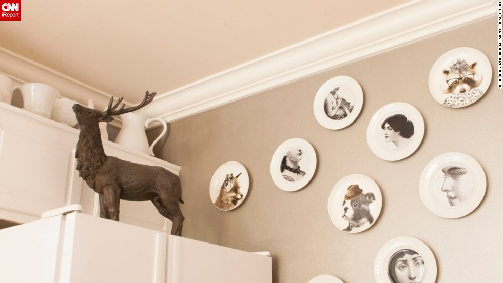 "Konya's shows a <a href=""http://cuckoo4design.blogspot.com/2013/09/winner-and-more-h.html"" target=""_blank"">collection of whimsical plates</a>, and a stern-looking reindeer atop her refrigerator."