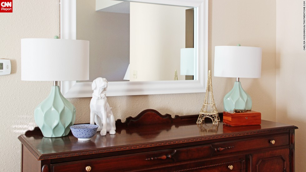 "<a href=""http://ireport.cnn.com/docs/DOC-1040611"">Chelsea McDonnough</a> adds <a href=""http://www.twotwentyone.net/"" target=""_blank"">sentimental decor</a> to an inherited buffet with this white ceramic dog figurine."