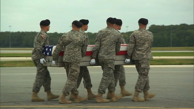 Bodies of slain troops arrive home