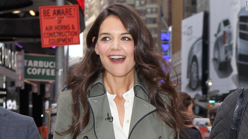 "Katie Holmes is in a great mood as she arrives at ""Good Morning America"" on October 9."