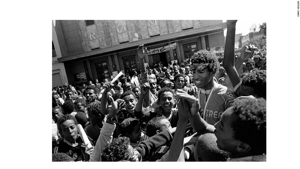 Eritrea's Daniel Telehaimanot, the country's most popular cyclist, is mobbed by spectators in front of Asmara's Roma Theatre after finishing second in the Giro dell'Eritrea -  a 700-mile, 10-stage event, that is Africa's oldest cycle race.