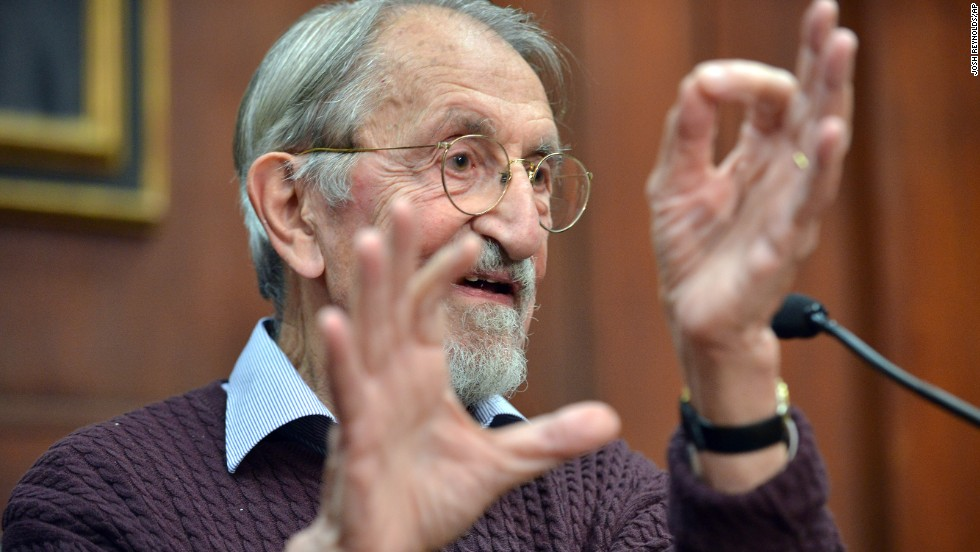Martin Karplus describes molecular behavior as he speaks to reporters at Harvard University in Cambridge, Massachusetts, after being awarded the Nobel Prize in chemistry on October 9.  The three men's work allows researchers to study chemical reactions, which take place very quickly, at a slower pace using a computer.