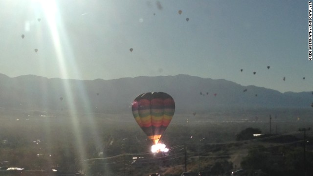 Hot air balloon hits power lines