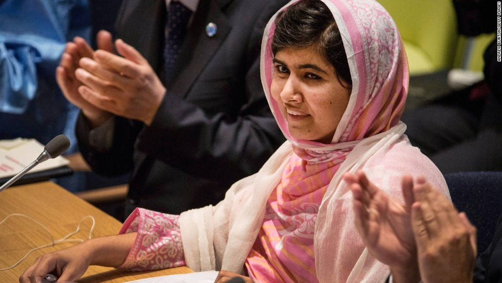 """Malala is applauded before she speaks at the United Nations Youth Assembly in New York on July 12, 2013, her 16th birthday. """"They thought that the bullets would silence us, but they failed,"""" she said. """"And then, out of that silence, came thousands of voices."""""""