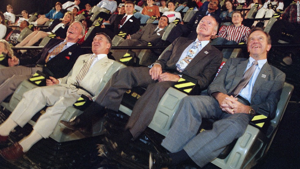 "Carpenter, left, with former Mercury 7 astronauts Wally Schirra, Gordon Cooper and Alan Shepard as they ride ""The Right Stuff"" Mach one flight simulation on April 28, 1995, at Six Flags Over Texas in Arlington, Texas. The 100-seat theater involves a five-story high screen and seats that move to help simulate flight vibrations."