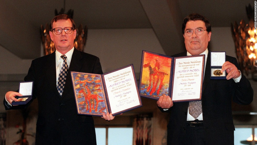 David Trimble, left, and John Hume hold up their diplomas and medals after receiving their Nobel Peace Prize in Oslo, Norway, on December 10, 1998. Trimble and Hume won the Nobel Peace Prize in 1998.