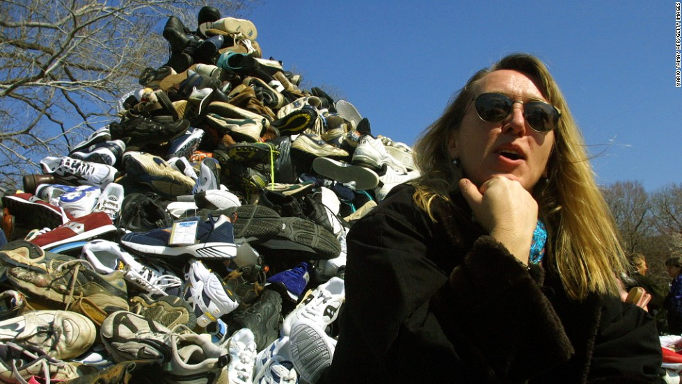 Jody Williams sits in front of donated shoes symbolizing landmine victims during Ban Landmines Week on March 8, 2001, on Capitol Hill in Washington. Williams and the International Campaign to Ban Landmines won the Nobel Peace Prize in 1997.