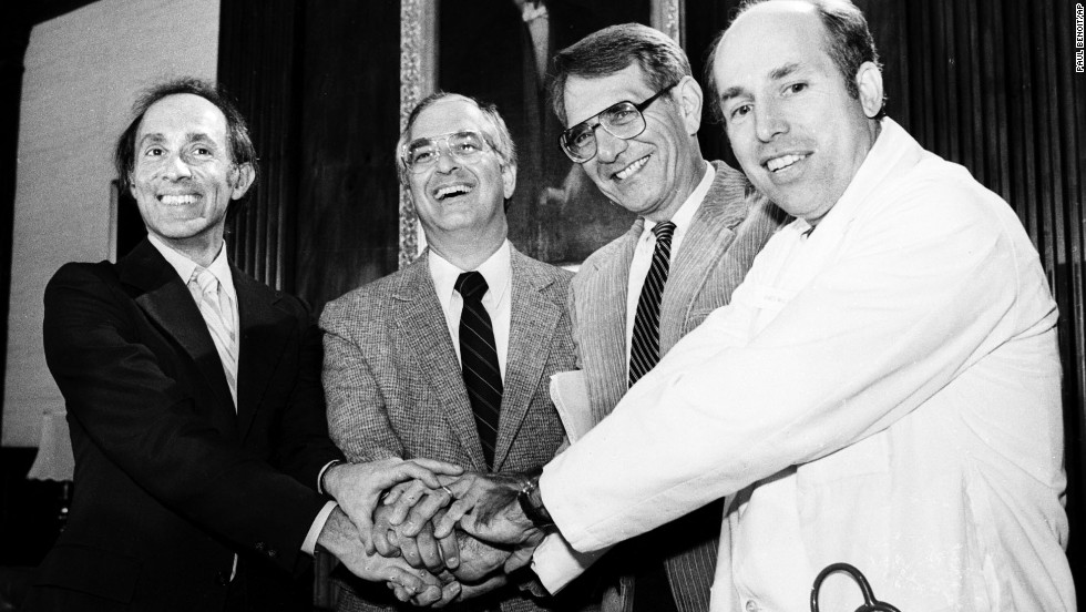 Members of the International Physicians for the Prevention of Nuclear War clasp hands on October 11, 1985, at the group's Boston headquarters after the organization was awarded the 1985 Nobel Peace Prize. The doctors are, from left, Eric Chivian, co-founder; John Pastore, secretary; Sidney Alexander, president of the U.S. affiliate group; and James Muller, co founder.