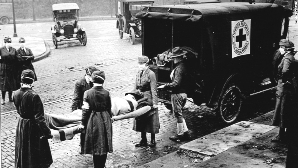 Members of the Red Cross Motor Corps, all wearing masks to protect against the further spread of the influenza epidemic, carry a patient on a stretcher into an ambulance in St. Louis in October 1918. The International Committee of the Red Cross won the Nobel Peace Prize in 1917.