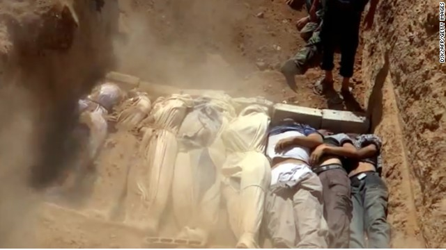 An image grab taken from a video uploaded on YouTube by the Local Committee of Arbeen on August 21, 2013 allegedly shows Syrians covering a mass grave containing bodies of victims that Syrian rebels claim were killed in a toxic gas attack by pro-government forces in eastern Ghouta and Zamalka, on the outskirts of Damascus. The allegation of chemical weapons being used in the heavily-populated areas came on the second day of a mission to Syria by UN inspectors, but the claim, which could not be independently verified, was vehemently denied by the Syrian authorities, who said it was intended to hinder the mission of UN chemical weapons inspectors. AFP PHOTO / YOUTUBE / LOCAL COMMITTEE OF ARBEEN== RESTRICTED TO EDITORIAL USE - MANDATORY CREDIT 'AFP PHOTO / YOUTUBE / LOCAL COMMITTEE OF ARBEEN' - NO MARKETING NO ADVERTISING CAMPAIGNS - DISTRIBUTED AS A SERVICE TO CLIENTS - AFP IS USING PICTURES FROM ALTERNATIVE SOURCES AS IT WAS NOT AUTHORISED TO COVER THIS EVENT, THEREFORE IT IS NOT RESPONSIBLE FOR ANY DIGITAL ALTERATIONS TO THE PICTURE'S EDITORIAL CONTENT, DATE AND LOCATION WHICH CANNOT BE INDEPENDENTLY VERIFIED == (Photo credit should read DSK/AFP/Getty Images)