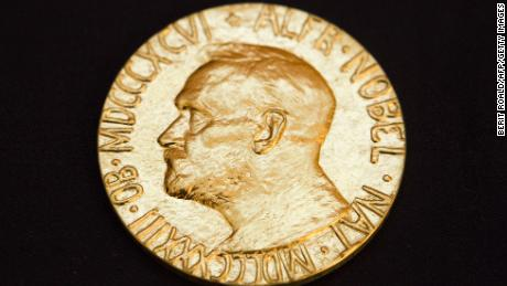 This picture taken on December 10, 2010 shows the front of the Nobel medal awarded to the Nobel Peace Prize laureate for 2010, jailed Chinese dissident Liu Xiabo. The Nobel Peace Prize ceremony began in Oslo Friday without guest of honour Liu Xiaobo, a jailed Chinese dissident who was represented by an empty chair at the event.  Other Chinese dissidents, ambassadors from a number of countries, Norway's king and queen and other dignitaries were present as the ceremony opened in a flower-decked Oslo city hall. AFP PHOTO / SCANPIX - Berit Roald (Photo credit should read BERIT ROALD/AFP/Getty Images)