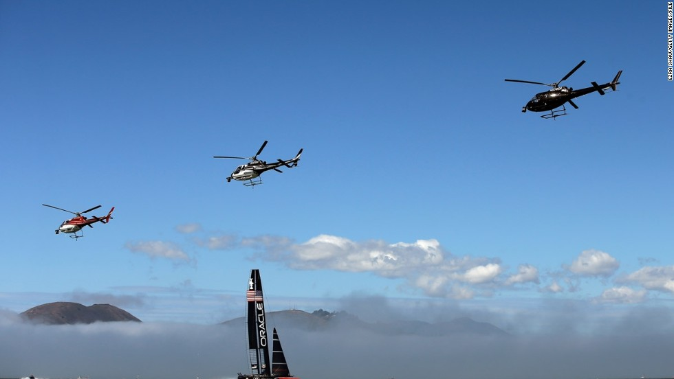 """Veteran sports photographer Ezra Shaw took to land, sea, and sky to capture these remarkable images of the America's Cup. """"Before each race, both teams would warm up by sailing most of the race course,"""" the 39-year-old Getty photographer explained. """"The television helicopters would also start the day by flying in a close formation across the course."""""""