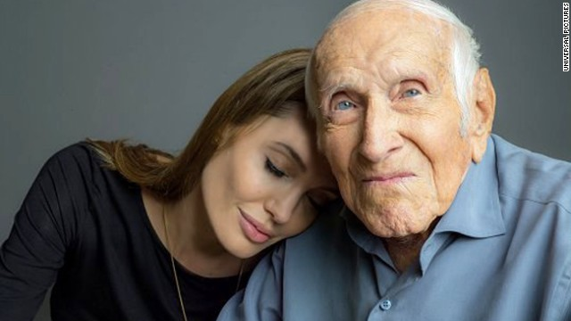 "Louis Zamperini with ""Unbroken"" director  Angelina Jolie in October. The film, based on the bestseller about his life, comes to theaters this Christmas."