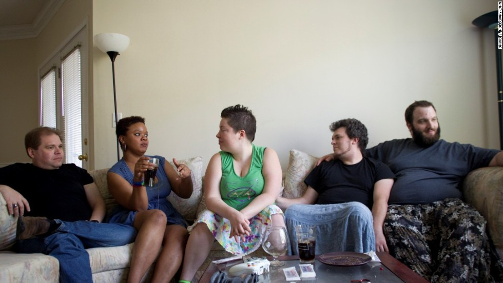 "The most common relationship dynamic in polyamory begins with a couple, married or unmarried, who might identify as straight, homosexual or bisexual and branches out to relationships with others -- sometimes referred to as ""metamors"" or ""polycules."" Still, relationships can be fluid. When this photograph was taken in 2012, John Stewart, right, lived with girlfriend Adi Howell, second from left, and the couple was seeing the rest of the people pictured. None are now involved in intimate relationships, but they remain friends."
