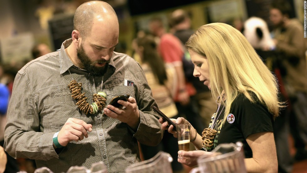 Matt Morris and Mikki Roth of Denver, Colorado use the official GABF app to take notes and track the beers they taste.