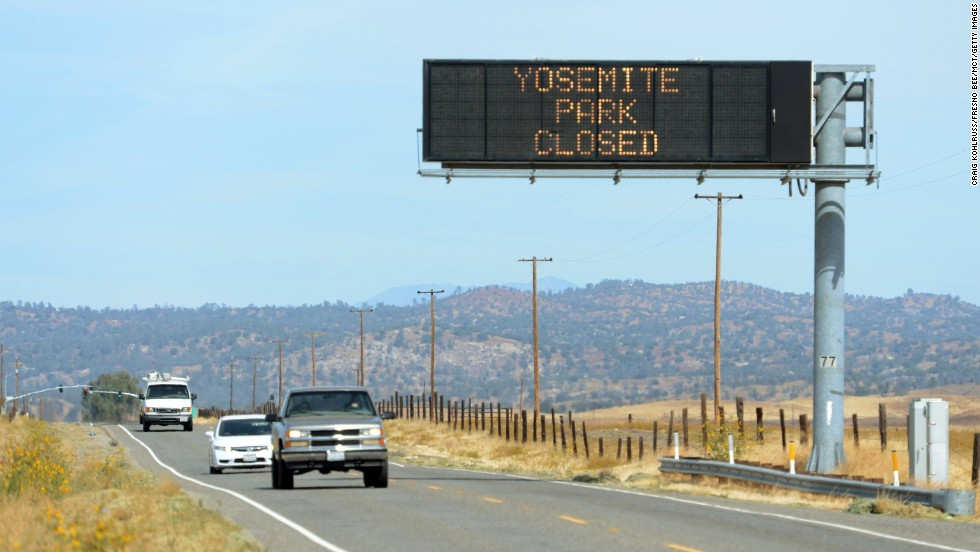 A sign on Highway 41, north of Fresno, California, tells motorists about the closure of Yosemite Park on October 1.