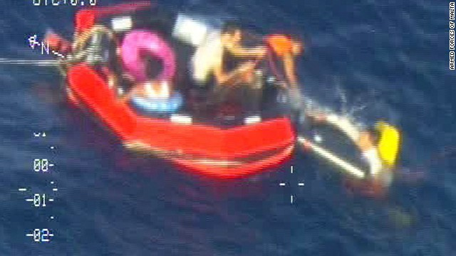 Survivors of the capsize near Lampedusa on Friday )ctober 11 are pictured in the sea.