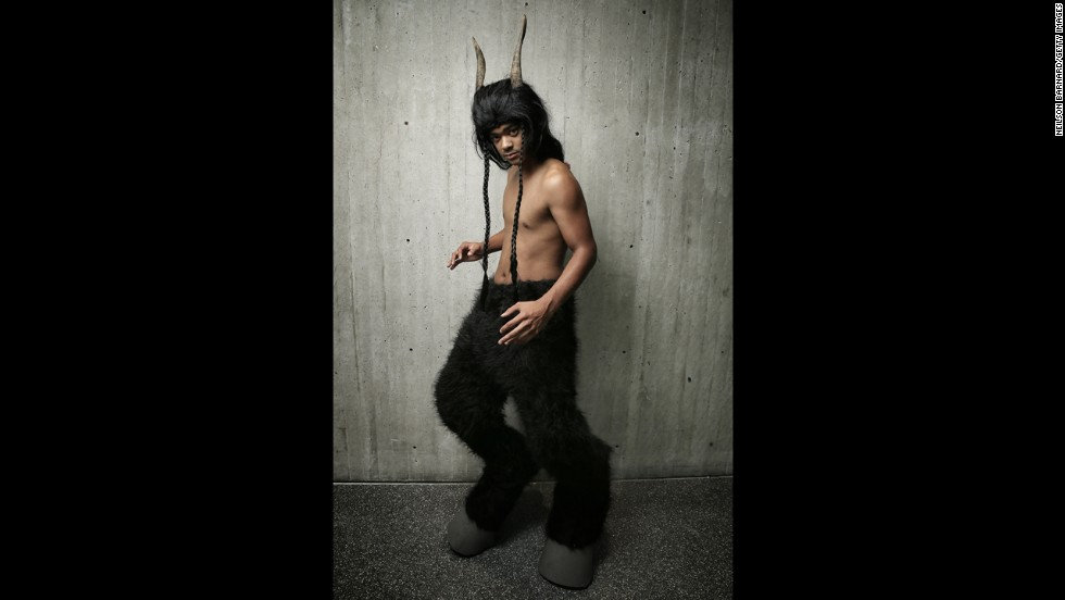 A fan poses dressed as a goat man.