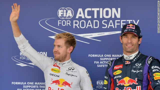 Sebastian Vettel, left, waved to his fans after Japanese Grand Prix qualifying but Mark Webber recorded the fastest time.