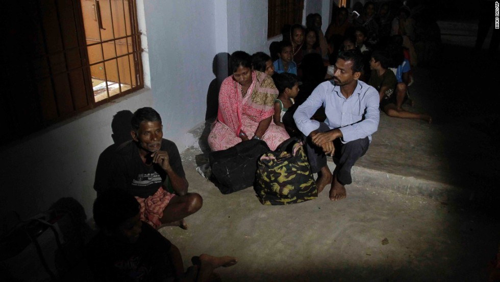 Evacuated villagers take shelter in a school building following the cyclone warning in Berhampur on Saturday, October 12.