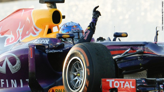 Sebastian Vettel gives his trademark victory salute after a superb drive to win the Japanese Grand Prix at Suzuka.