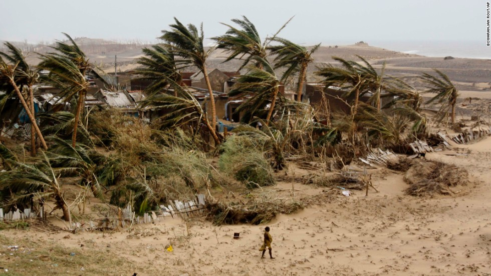 A woman returns to the village of Arjipalli on India's Bay of Bengal coast on October 13.