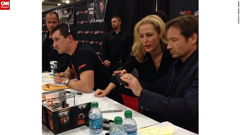 """X-Files"" stars Gillian Anderson and David Duchovny -- here taking a photo of a fan's diorama -- <a href=""http://t.co/1dMT9oa3iu"" target=""_blank"">reunited</a> for the show's 20th anniversary."