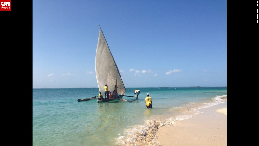 "Tour guide Scott Isom says he was excited to go to Zanzibar because it shows a different side of Africa. With his tour group he explored the island and rode a wooden catamaran. He called this Indian Ocean scene ""a postcard waiting to happen."""