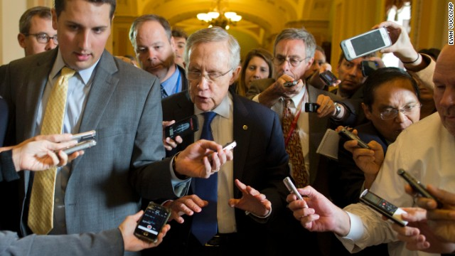 """Senate Majority Leader Sen. Harry Reid, D-Nev., is surrounded by reporters after leaving the office of Senate Minority Leader Sen. Mitch McConnell, R-Ken., on Capitol Hill on Monday, Oct. 14, 2013 in Washington. Reid reported progress Monday toward a deal to avoid a threatened default and end a two-week partial government shutdown as President Barack Obama called congressional leaders to the White House to press for an end to the impasse. """"We're getting closer,"""" Reid told reporters. (AP Photo/ Evan Vucci)"""