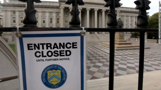 A closed sign hangs at the entrance to the U.S. Treasury building in Washington D.C., on October 3. The first face-to-face talks between President Barack Obama and congressional leaders failed to break the budget logjam as a partial U.S. government shutdown entered its third day.