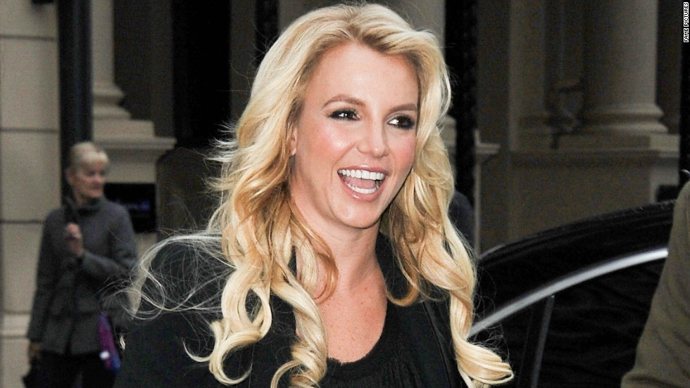 Britney Spears is all smiles as she visits Capital FM radio in London on October 14.