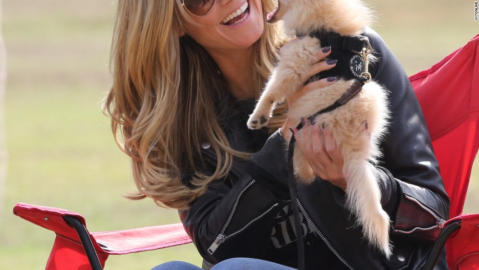 Heidi Klum cuddles up to a cute pup on October 13.