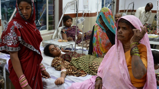 Indian Hindu devotees, injured during the October 13 stampede, recuperate at the Datia district hospital in Datia, central Madhya Pradesh state, on October 14, 2013. Outrage mounted in India after at least 115 devotees were crushed to death or drowned near a Hindu temple, the site of another deadly stampede only seven years ago. AFP PHOTO/SAJJAD HUSSAIN (Photo credit should read SAJJAD HUSSAIN/AFP/Getty Images)