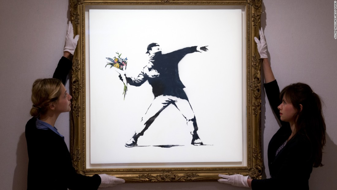 "Despite his anti-establishment roots, Banksy has gone on to garner great enthusiasm from the high-end art market world. This stencil print ""Love is in the Air"" sold for $248,000 in 2013."